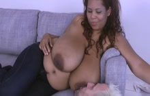 Huge boobed ebony lets a white dude grope her tits