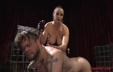 Lusty mistress playing with her tied slave boy