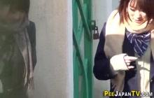 Japanese teens in highschool uniforms urinate