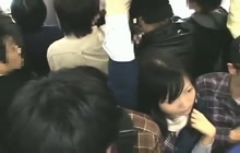 Stranger rubs Japanese girl's pussy on a train
