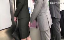 Groping business woman in train